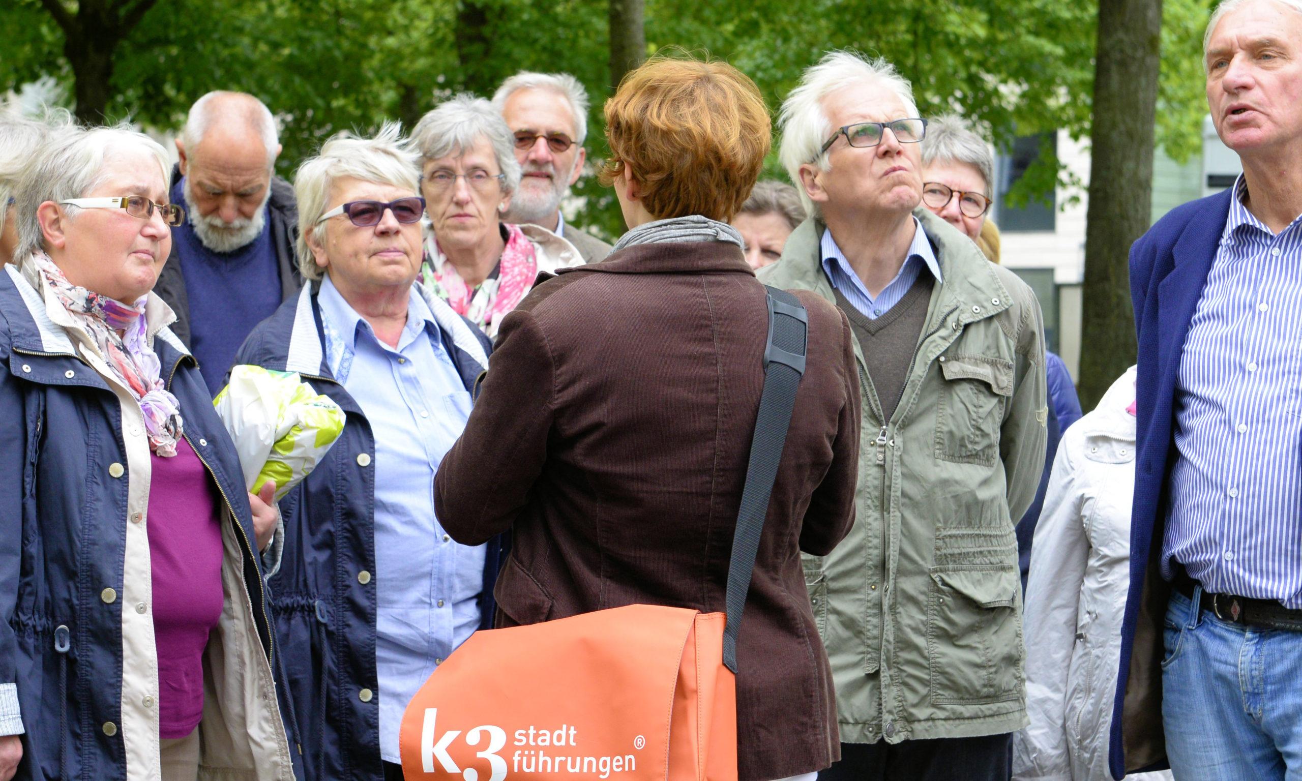 Gruppe bei einer Stadtführung in Münster